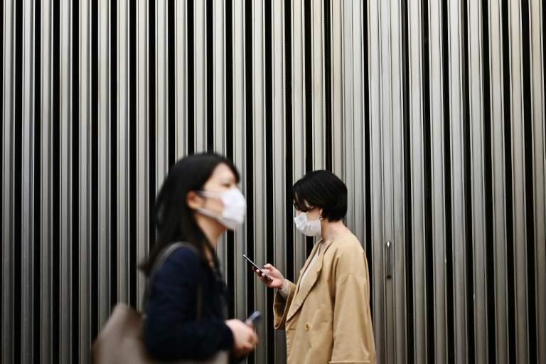 Les masques omniprésents en Asie, mais leur efficacité fait débat